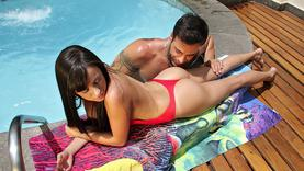 brunette pornstar licking asshole in the pool