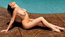 oiled brunette girl in the pool