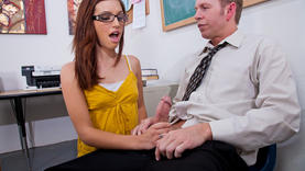 brunette whore in glasses doing handjob